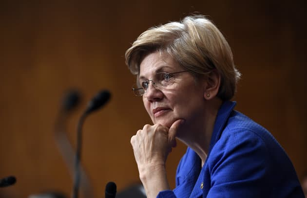 Sen. Elizabeth Warren, D-Mass., listens to Federal Reserve Chair Janet Yellen testify before the Senate Banking, Housing, Urban Affairs Committee on Capitol Hill in Washington, Thursday, July 16, 2015. (AP Photo/Susan Walsh)